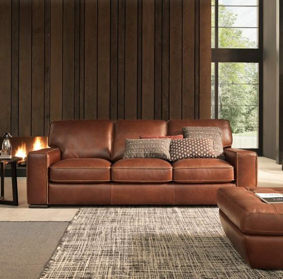 Warm, brown leather Natuzzi Editions sofa in a chocolate panelled room